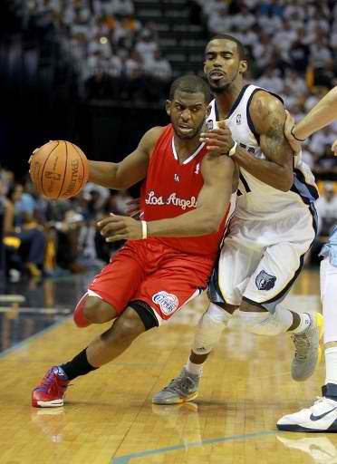 Chris Paul #3 of the Los Angeles Clippers dribbles the ball while defended by Mike Conley #11 of the Memphis Grizzlies the in Game One of the Western Conference Quarterfinals in the 2012 NBA Playoffs at FedExForum on April 29, 2012 in Memphis, Tennessee. Photo Courtesy of Andy Lyons/Getty Images North America/ AFP