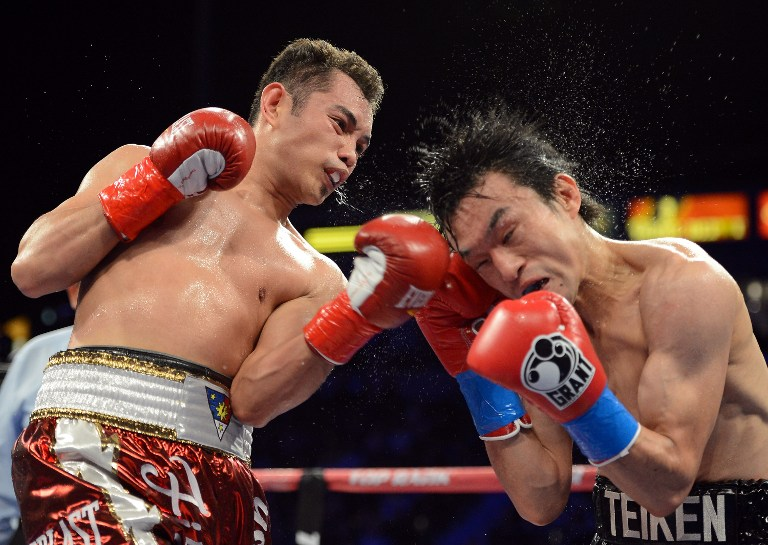 HANGING UP GLOVES. Filipino boxer Nonito Donaire defeated Toshiaki Nishioka, leading the latter to retirement. File photo by AFP.