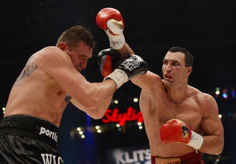 DOMINANT WIN. World heavyweight champion Wladimir Klitschko successfully defended his IBF, WBA and WBO titles on Saturday, November 10 with a unanimous points victory over Polish challenger Mariusz Wach. AFP.