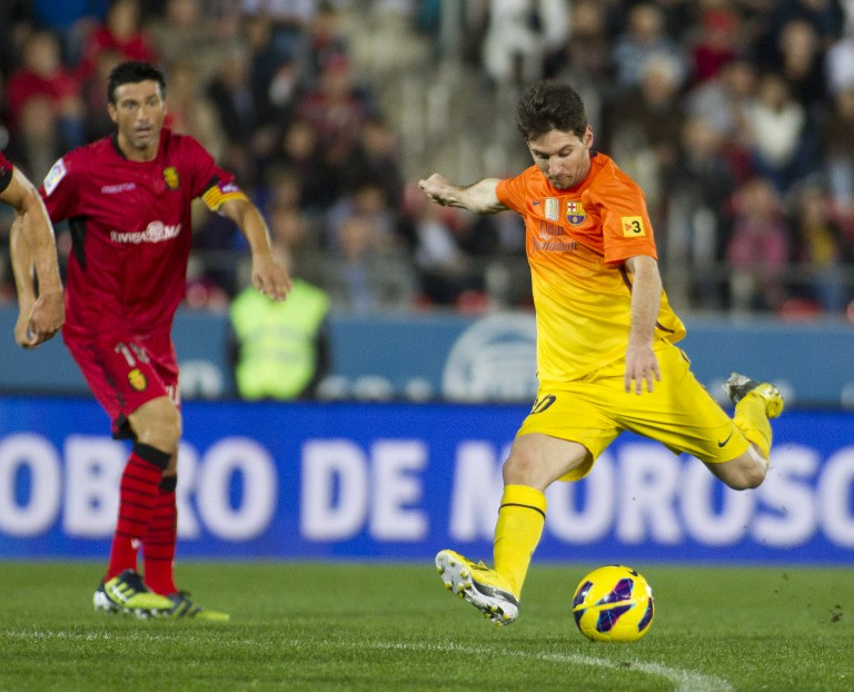 MESSI OVERTAKES PELE. Barcelona's Argentinian forward Lionel Messi scores during the Spanish league football match Mallorca vs FC Barcelona at the Iberostar stadium, causing him to break Pele's record tally. AFP.