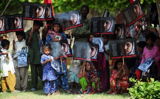"MALALA DAY. Pakistani flood affected victims carry photographs of child activist Malala Yousafzai to mark the ""Malala Day"" in Karachi on November 10, 2012. As the world prepared to mark ""Malala Day"" to support the Pakistani teenager shot by the Taliban for promoting girls' education, security fears in her hometown meant her schoolmates could not honour her in public. AFP PHOTO / RIZWAN TABASSUM"