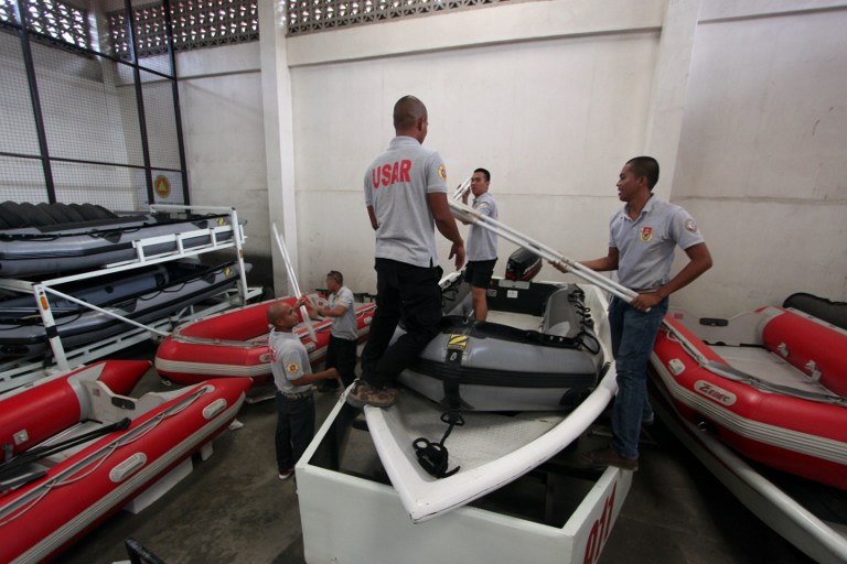 RESCUE EFFORTS. Rescuers prepare their equipments at their quarters in Davao City, in southern island of Mindanao for Typhoon Bopha. Photo by AFP.