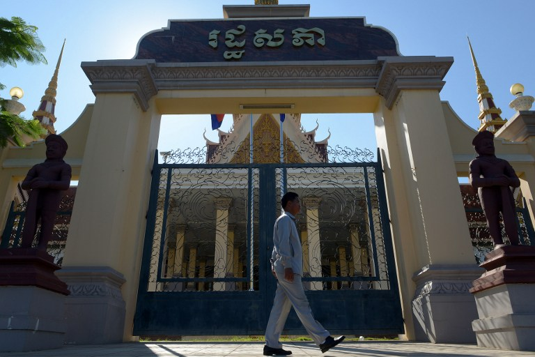 NO DENIAL. A Cambodian guard walks past the main gate of the National Assembly building in Phnom Penh. Cambodia banned the denial of atrocities committed by the Khmer Rouge regime with a new law. AFP/ Tang Chhin Sothy