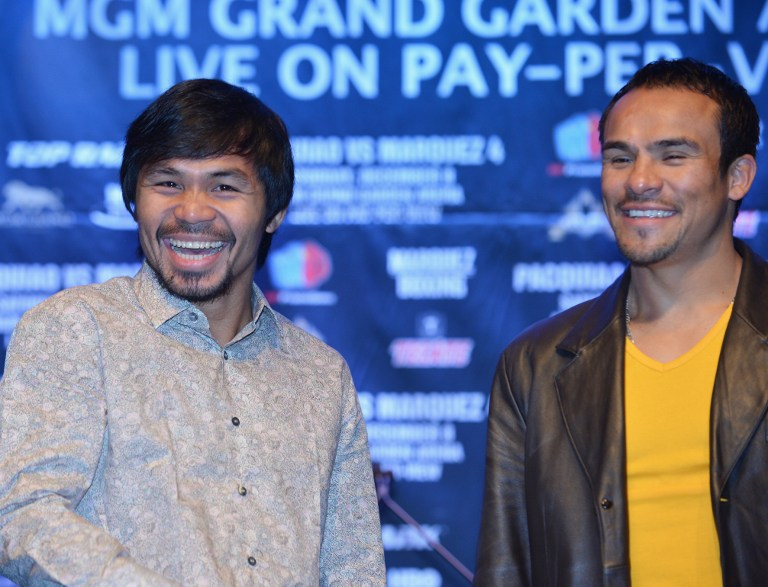 "BETTER MOOD. ""He's having fun with it,"" trainer Freddie Roach said of his prized fighter Manny Pacquiao on training for his fourth bout against Juan Manuel Marquez. File photo by AFP."