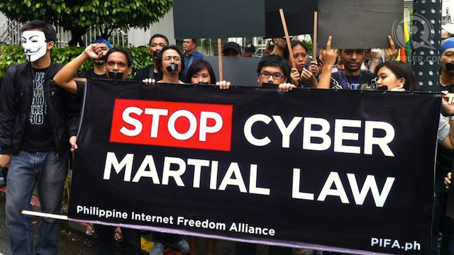 FOR INTERNET FREEDOM. Members of the Philippine Internet Freedom Alliance (PIFA) protest against the Cybercrime Law outside the gate of the Supreme Court in Padre Faura, Manila, October 2, 2012. File photo by Purple Romero.