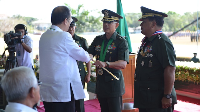 CHANGE OF COMMAND: President Aquino hands over the Command Saber to the incoming 56th Commanding General, Philippine Army Maj. Gen. Hernando DCA Iriberri. President Aquino presided over the Philippine Army Change of Command Ceremony. Photo from the Philippine Army