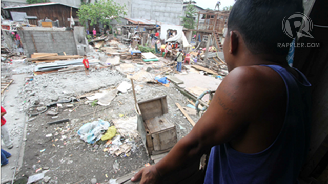 DEMOLISHED COMMUNITY. Deferred in 2011, a controversial demolition pushes through in Davao City. Photo by Karlos Manlupig