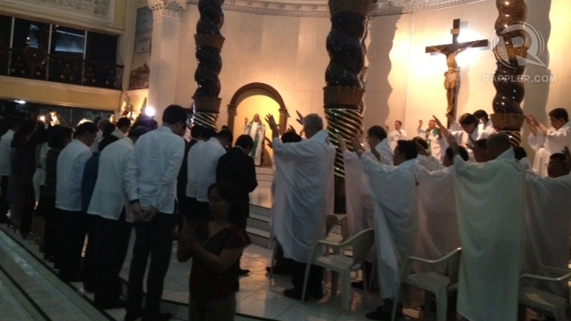 CHURCH'S BLESSING. Catholic bishops and priests bless anti-RH bill legislators during a special Mass. Photo by Paterno Esmaquel II