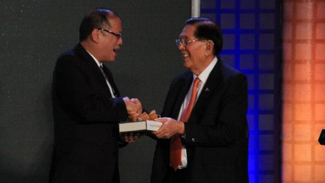 FIRST COPY: Senate President Juan Ponce Enrile gives President Aquino a copy of his memoir (Photo by Fung Yu)