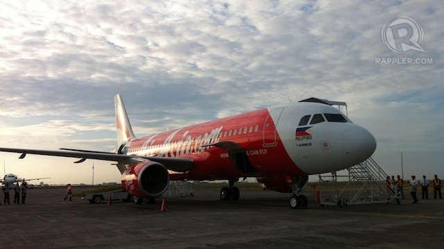 READY TO FLY. AirAsia Philippines Flight PQ7001, bound for Kalibo, at the tarmac of the Diosdado Macapagal International Airport, minutes before its inaugural flight, March 28, 2012. Photo by KD Suarez