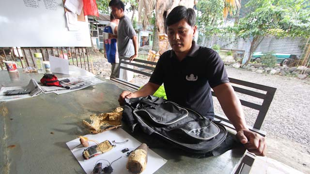 EXPLOSIVE DEVICE. SPOI Marcial Aplasca, ordnance specialist of the Davao City Police Office, shows the construct of the improvised explosive device recovered from a suspected Malaysian Jemaah Islamiyah member who was shot dead by local security forces in Davao City on Friday evening. Photo by Karlos Manlupig
