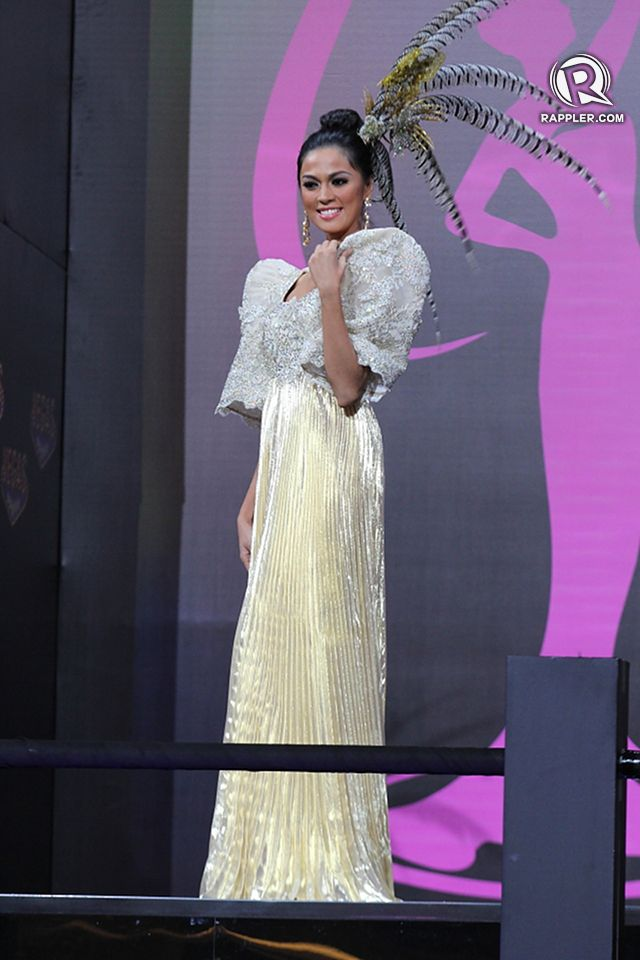 SHE GLOWS. Miss Universe-Philippines Ariella Arida at the National Costume competition on November 3, 9pm at Vegas Mall in Moscow. She wears a terno designed by Alfredo Barraza. All photos for Rappler by Jory Rivera/OPMB
