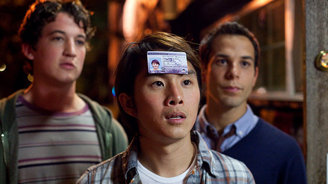 HERE'S MY CARD. Justin Chon ― with Miles Teller (left) and Skylar Astin ― relishes a legal-age perk. All images by Relativity Media