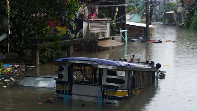 WATERWORLD. Jeep stranded in a flooded area in Quezon City. Photo by Maurits van Linder