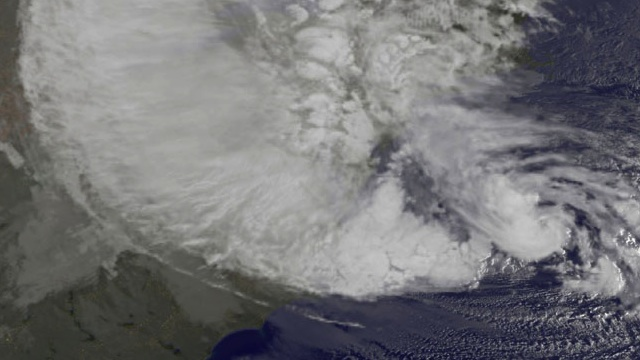 NOAA's GOES-13 satellite captured this visible image of Hurricane Sandy battering the U.S. East coast on Monday, Oct. 29 at 9:10 a.m. EDT. Sandy's center was about 310 miles south-southeast of New York City. Tropical Storm force winds are about 1,000 miles in diameter. Credit: NASA GOES Project
