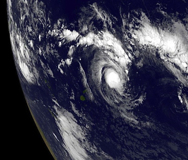 NOAA's GOES-15 satellite captured this visible image of newborn Tropical Storm Evan in the South Pacific on Dec. 12, 2012 at 1500 UTC (10 a.m. EST). Credit: NASA GOES Project