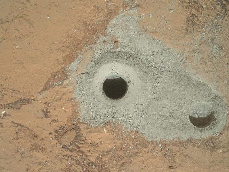 "DRILL, BABY, DRILL. At the center of this image from NASA's Curiosity rover is the hole in a rock called ""John Klein"" where the rover conducted its first sample drilling on Mars. Image credit: NASA/JPL-Caltech/MSSS"