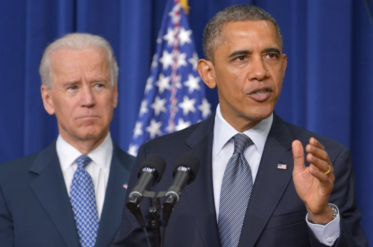 US President Barack Obama speaks on proposals to reduce gun violence as Vice President Joe Biden watches on January 16, 2013 in the South Court Auditorium of the Eisenhower Executive Office Building, next to the White House in Washington, DC. AFP PHOTO/Mandel Ngan