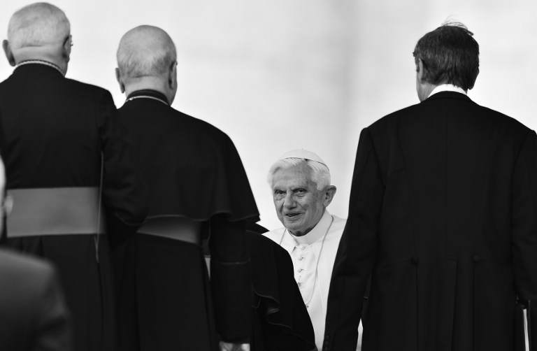 LAST GOODBYE. A black and white photo shows Pope Benedict XVI greeting priests and bishops on May 16, 2012 in Saint-Peter's square at the end of his weekly general audience. VINCENZO PINTO, AFP PHOTO.