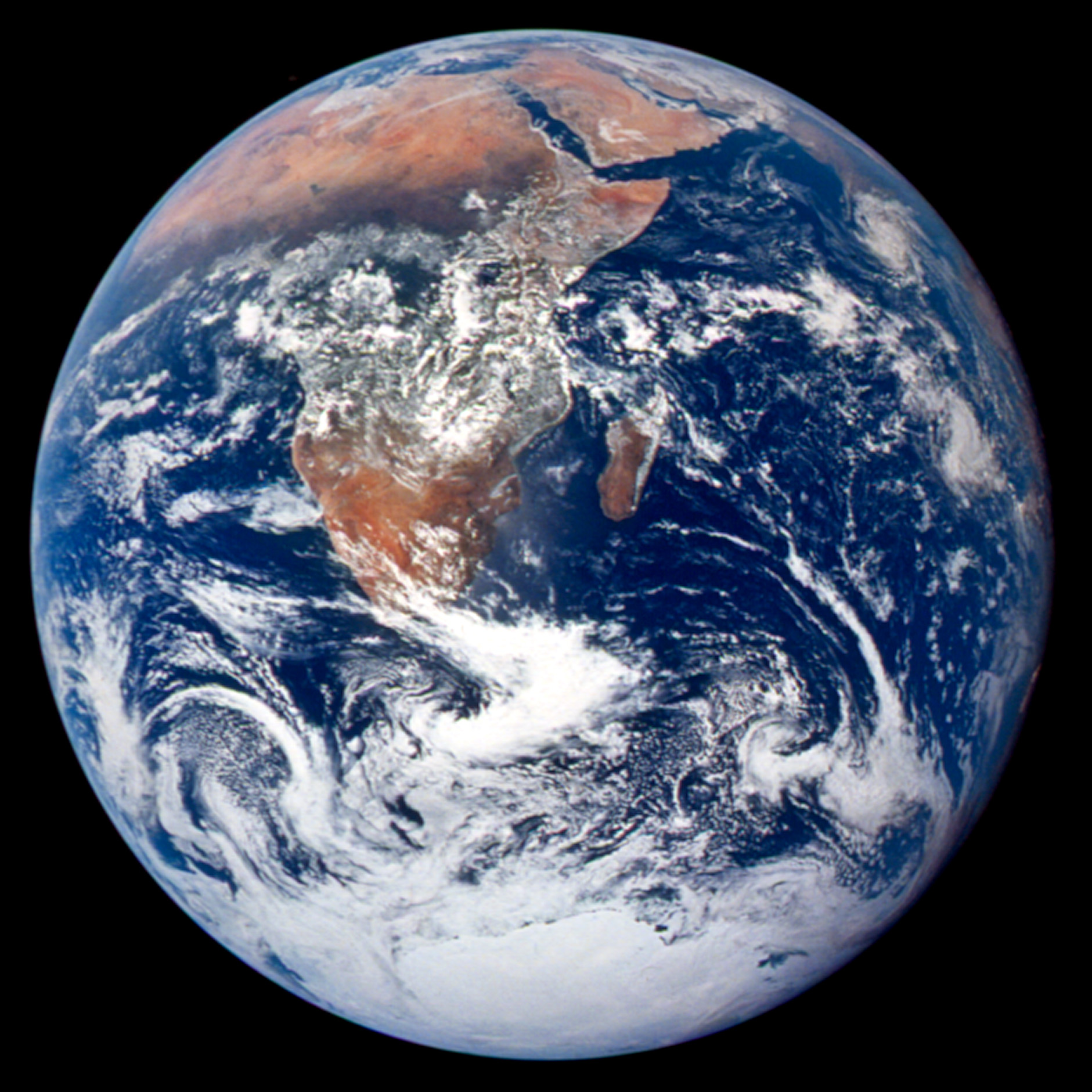BLUE MARBLE 1972. This classic photograph of the Earth was taken on December 7, 1972. The original caption is reprinted below:  View of the Earth as seen by the Apollo 17 crew traveling toward the moon. This translunar coast photograph extends from the Mediterranean Sea area to the Antarctica south polar ice cap. This is the first time the Apollo trajectory made it possible to photograph the south polar ice cap. Note the heavy cloud cover in the Southern Hemisphere. Almost the entire coastline of Africa is clearly visible. The Arabian Peninsula can be seen at the northeastern edge of Africa. The large island off the east coast of Africa is the Republic of Madagascar. The Asian mainland is on the horizon toward the northeast. Astronaut photograph AS17-148-22727 courtesy NASA Johnson Space Center Gateway to Astronaut Photography of Earth