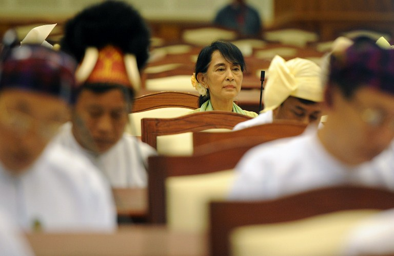 Myanmar opposition leader Aung San Suu Kyi (C) attends the lower house parliament session in Naypyidaw on July 9, 2012. Suu Kyi made her historic parliamentary debut on July 9, marking a new phase in her near quarter century struggle to bring democracy to her army-dominated homeland. AFP PHOTO / Soe Than WIN