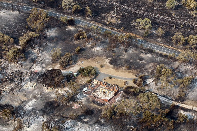 FIRE CASUALTY. This aerial photograph taken on January 5, 2013 shows the devastation to property between Dunalley and Boomer Bay after bush fires swept through the area. AFP PHOTO / POOL / Chris Kidd