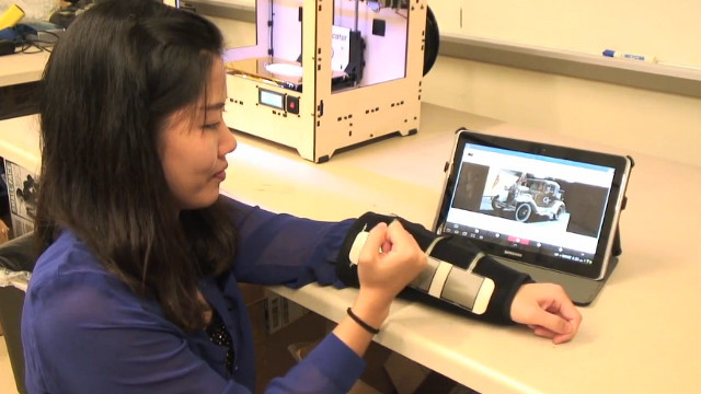 HELPFUL ACCESS. Georgia Tech's new device should help kids with fine-motor impairment to use tablets. Screen grab from YouTube
