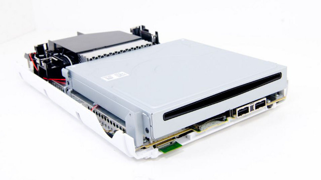 WII U TEARDOWN. A partially dismantled Wii U unit. Photo from http://www.anandtech.com/show/6465/nintendo-wii-u-teardown