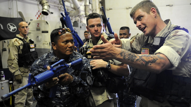 JOINT TRAINING. US soldiers train a member of the Philippine Coast Guard during one of their joint exercises in Mindanao. (Photo from Joint Special Operations Task Force-Philippines)
