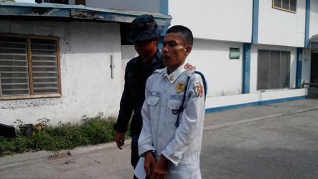 ARRESTED. Alias Kim being taken into police custody. Photo by Richard Falcatan