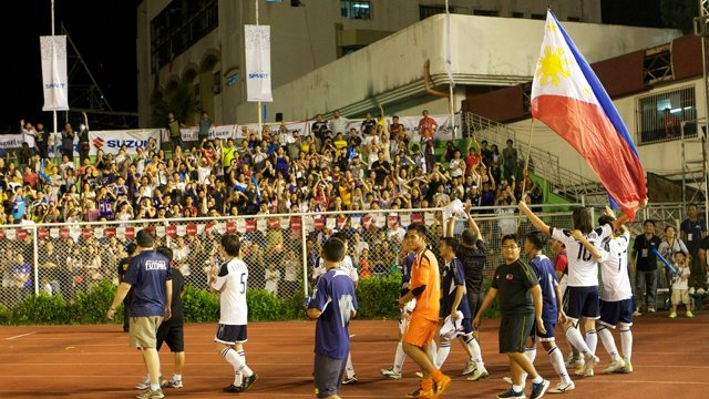 PINOY PRIDE. Azkals wave the Philippine flag after their game against LA Galaxy. December 3, 2011. Rupert Ambil.