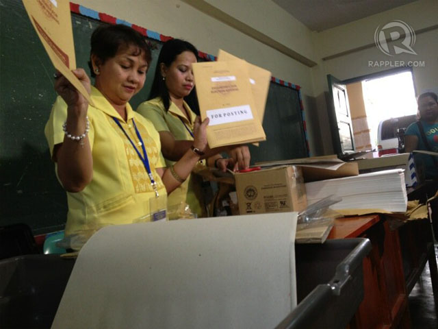 AT CRAME. Comelec team starts to set up and check election paraphernalia. Photo by Paterno Esmaquel II