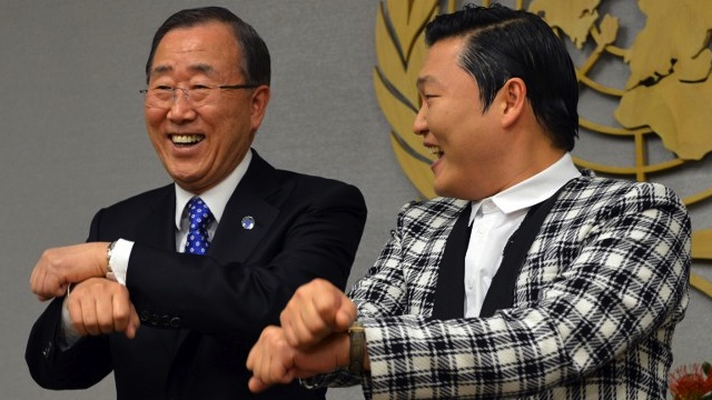 DIPLOMACY, GANGNAM STYLE. South Korean singer Psy (R), whose real name Park Jae-sang, does a dance-step with United Nations Secretary General Ban Ki-Moon (L) just before their meeting October 23, 2012 at UN headquarters in New York. AFP PHOTO/Stan HONDA