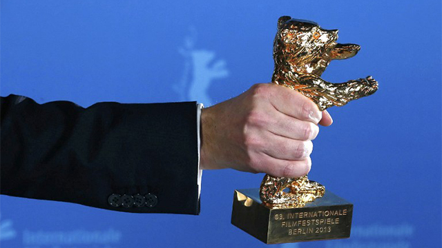 "GOLDEN BEAR. The Golden Bear award for the Best Film is held by winner Calin Peter Netzer for the film ""Pozitia Copilului"" (Child's Pose) during the 63rd Berlinale Film Festival in Berlin AFP PHOTO/THOMAS PETER"