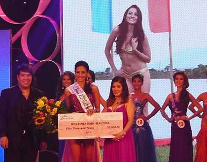 BEST IN SWIMSUIT. Rehman received a P50,000 check as part of her prizes for this award.