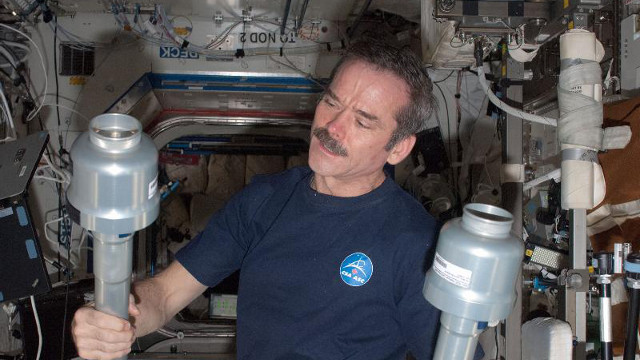 SPACE HANGOUT. Canadian Space Agency astronaut Chris Hadfield, Expedition 34 flight engineer, in the Destiny laboratory of the International Space Station. Photo from NASA