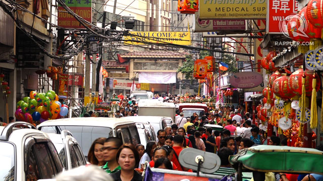 BUSY STREETS. The streets of Chinatown, Binondo are packed with revelers and festival-goers