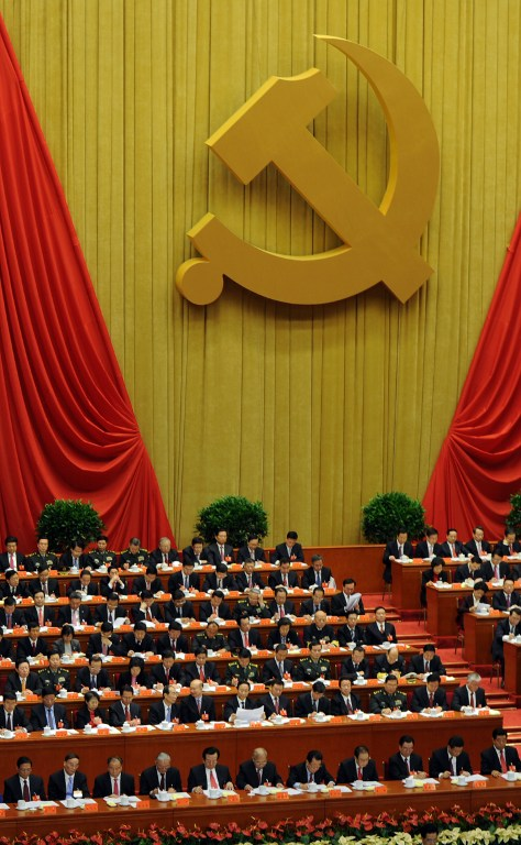 Delegates listen the speech of Chinese president Hu Jintao at the opening of the 18th Communist Party Congress at the Great Hall of the People in Beijing on 08 November 2012. AFP PHOTO/GOH CHAI HIN