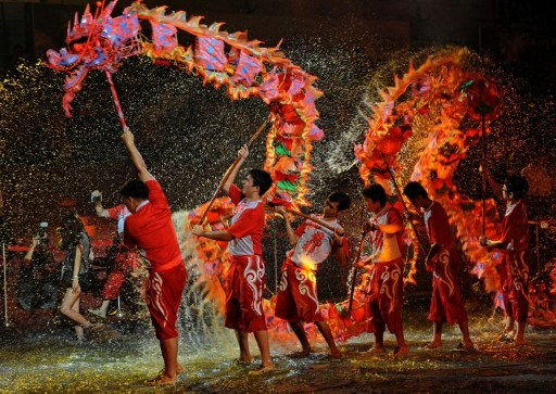 CHEERS. Dragon dancers during Chinese New Year 2012 celebrations. Photo by AFP