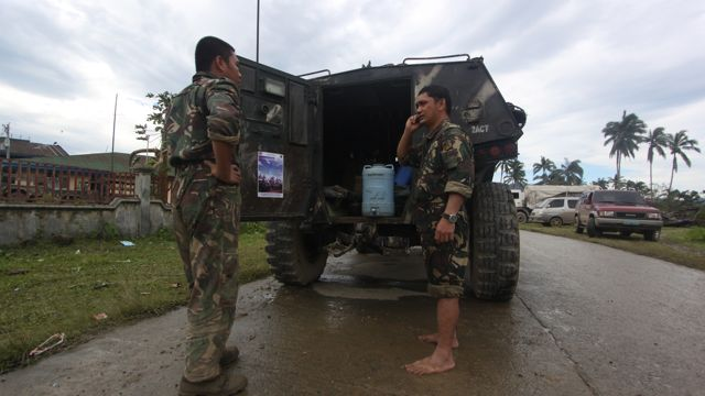 BAREFOOT SOLDIERS. Troops help in continued search and rescue operations in Compostela Valley, one of the hardest hit areas by typhoon Pablo. Photo by Karlos Manlupig