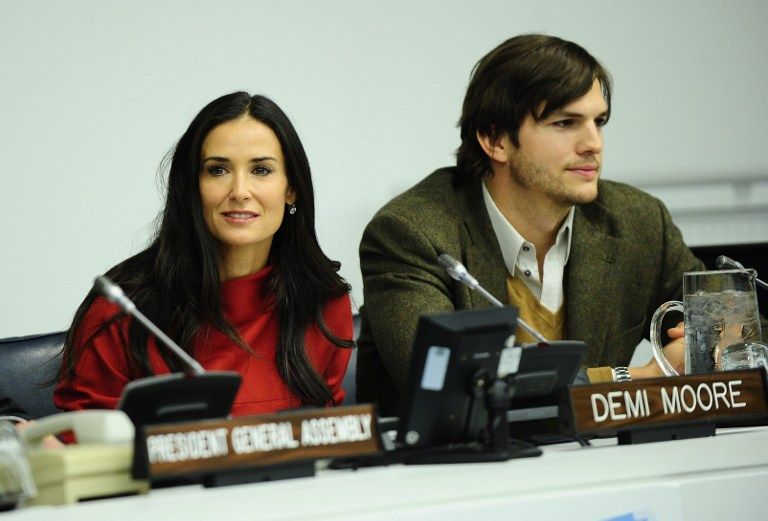 HAPPIER TIMES. Demi Moore and husband actor Ashton Kutcher addresses attend the launch of a UN fund aimed at helping fight against human trafficking at the United Nations headquarters in New York, November 4, 2011. AFP PHOTO/Emmanuel Dunand