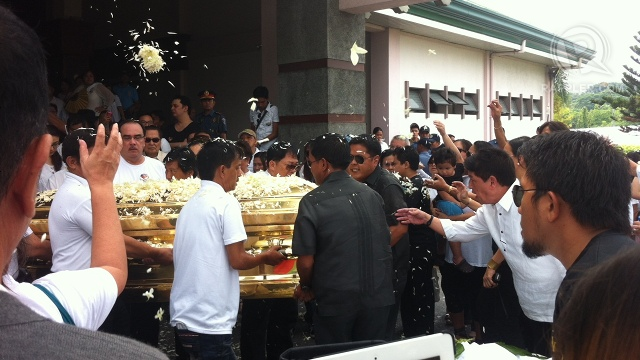 BURIAL. Dolphy's remains were encased in a glass-topped golden metal casket that he himself bought in the 1970s. It is shown here carried by pall bearers from the chapel to the nearby burial site. Photo by Natashya Gutierrez
