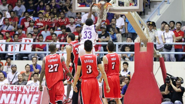 SOARING. Michael Dunigan soared above very Alaska Ace for a slam. Photo by Nuki Sabio/PBA Images