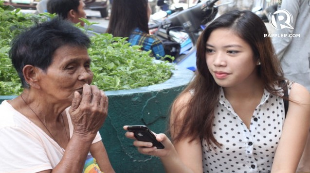 CITIZEN JOURNALISM: Rappler mover Alyza Bordeos interviews a mock voter for the coverage of the Dumaguete City mock polls. Photo by Kimberly Limpahan.