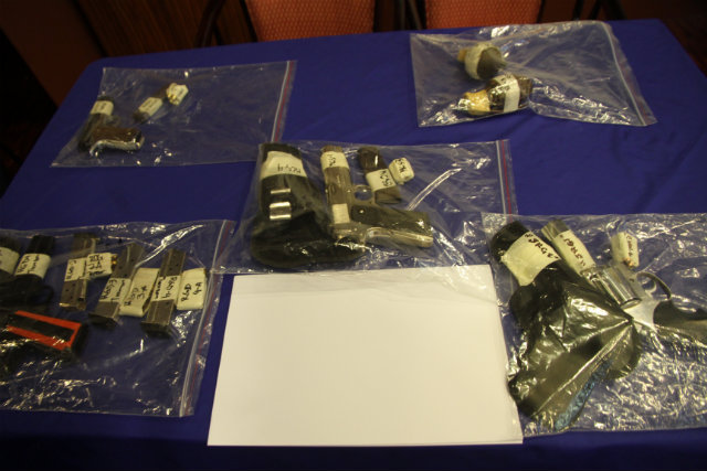 EVIDENCE? In this handout photo, the PNP present what they allege are the illegal firearms confiscated during Benito and Wilma Tiamzon's arrest. Photo by PNP PIO