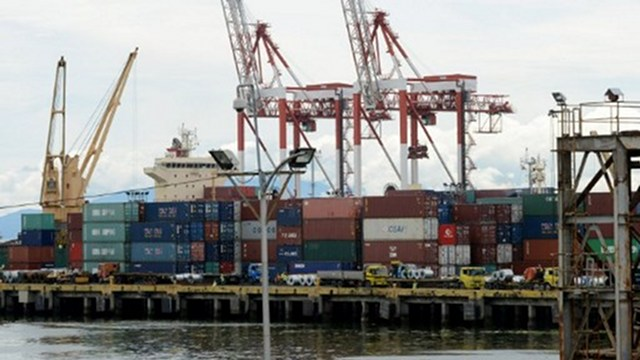 EXPORTS. A crane stacks shipping containers of Philippine products for export at the international container port in Manila. Photo by AFP