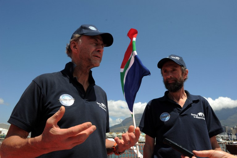 Explorers Sir Ranulph Fiennes (L) and Anton Bowring talk to journalists on January 6, 2013 in Cape Town. AFP PHOTO / ALEXANDER JOE