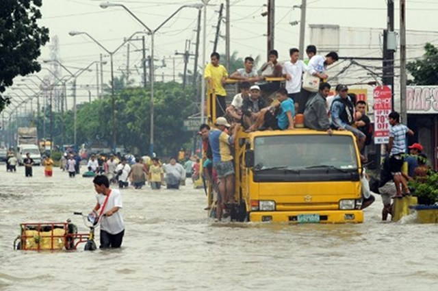 DISASTERS. Capital Manila battled floods during monsoon rain in August. Asia's cities are becoming increasingly vulnerable to natural disasters as they struggle with poor planning, population explosions and climate change, the Asian Development Bank warns. Photo by AFP