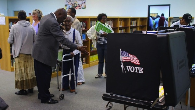 FLORIDA VOTES. Voters prepare to cast their ballots at the North Miami Public Library after standing in line on November 1, 2012 in North Miami, Florida. Joe Raedle/Getty Images/AFP