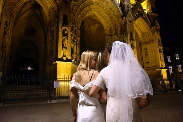 GAY MARRIAGE. Members of the efFRONTe-e-s collective pose during a fake wedding as part of a gay-friendly and pro-secular happening, on October 30, 2012, in front of Sainte-Clothilde Basilica in Paris. AFP PHOTO /THOMAS SAMSON
